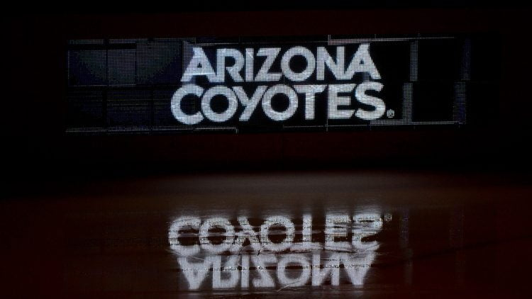 Oct 14, 2017; Glendale, AZ, USA; The Arizona Coyotes logo is reflected on the ice prior to the game against the Boston Bruins at Gila River Arena. Mandatory Credit: Matt Kartozian-USA TODAY Sports