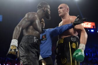 Feb 22, 2020; Las Vegas, Nevada, USA; Deontay Wilder and Tyson Fury stare at one another during their WBC heavyweight title bout at MGM Grand Garden Arena. Fury won via seventh round TKO. Mandatory Credit: Joe Camporeale-USA TODAY Sports