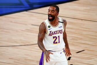 Oct 4, 2020; Orlando, Florida, USA; Los Angeles Lakers guard JR Smith (21) celebrates after making a three point basket against the Miami Heat during the second quarter of game three of the 2020 NBA Finals at AdventHealth Arena. Mandatory Credit: Kim Klement-USA TODAY Sports