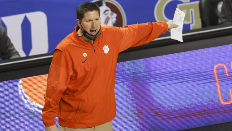 Mar 10, 2021; Greensboro, North Carolina, USA; Clemson Tigers head coach Brad Brownell yells at an official as his team plays the Miami Hurricanes during the second half in the second round of the 2021 ACC tournament at Greensboro Coliseum. The Miami Hurricanes won 67-64. Mandatory Credit: Nell Redmond-USA TODAY Sports