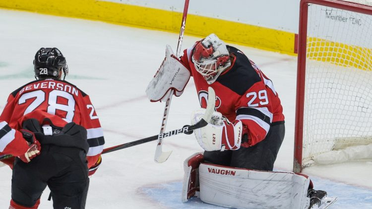 Apr 11, 2021; Newark, New Jersey, USA; New Jersey Devils goaltender Mackenzie Blackwood (29) makes a save in front of defenseman Damon Severson (28) during the first period against the Pittsburgh Penguins at Prudential Center. Mandatory Credit: Vincent Carchietta-USA TODAY Sports