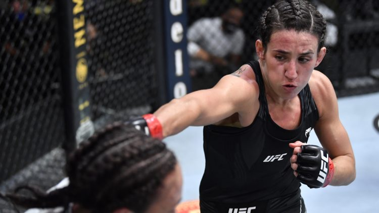 May 8, 2021; Las Vegas, NV, USA; Marina Rodriguez of Brazil punches Michelle Waterson in a flyweight fight during the UFC Fight Night event at UFC APEX on May 08, 2021 in Las Vegas, Nevada.    Mandatory Credit: Chris Unger/Handout Photo via USA TODAY Sports