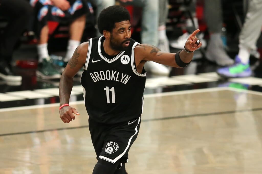 Jun 5, 2021; Brooklyn, New York, USA; Brooklyn Nets point guard Kyrie Irving (11) reacts after making a basket against the Milwaukee Bucks during the second quarter of game one in the Eastern Conference semifinals of the 2021 NBA Playoffs at Barclays Center. Mandatory Credit: Brad Penner-USA TODAY Sports