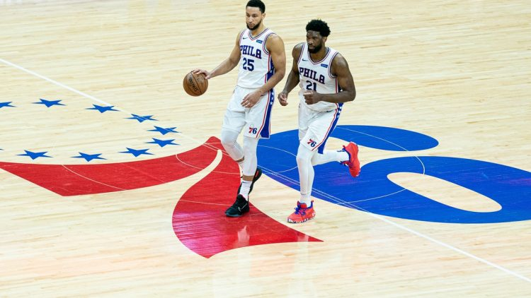 Jun 20, 2021; Philadelphia, Pennsylvania, USA; Philadelphia 76ers center Joel Embiid (21) and guard Ben Simmons (25) in action against the Atlanta Hawks during the second quarter of game seven of the second round of the 2021 NBA Playoffs at Wells Fargo Center. Mandatory Credit: Bill Streicher-USA TODAY Sports