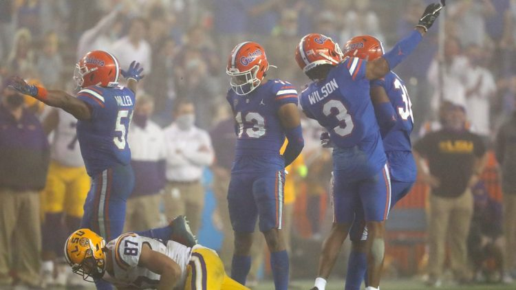 After a tackle Florida Gators defensive back Marco Wilson (3) throws the shoe of LSU tight end Kole Taylor (87) which resulted in a personal foul penalty against Wilson, during a game against the LSU Tigers at Ben Hill Griffin Stadium in Gainesville, Fla. Dec. 12, 2020. Florida lost 37-34 to the Tigers.  Sports Mcclenny02