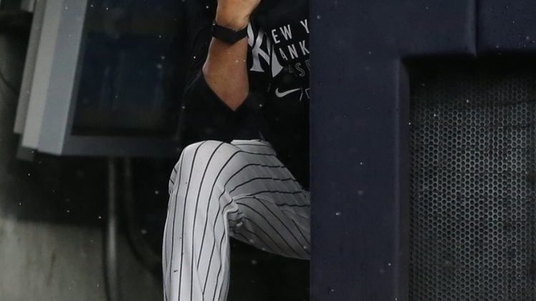 Jul 17, 2021; Bronx, New York, USA; New York Yankees manager Aaron Boone (19) watches during the sixth inning against the Boston Red Sox at Yankee Stadium. Mandatory Credit: Brad Penner-USA TODAY Sports