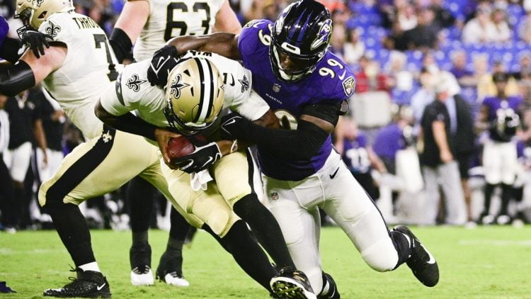Aug 14, 2021; Baltimore, Maryland, USA; Baltimore Ravens linebacker Odafe Oweh (99) leaps to sack New Orleans Saints quarterback Jameis Winston (2) during the first half  at M&T Bank Stadium. Mandatory Credit: Tommy Gilligan-USA TODAY Sports