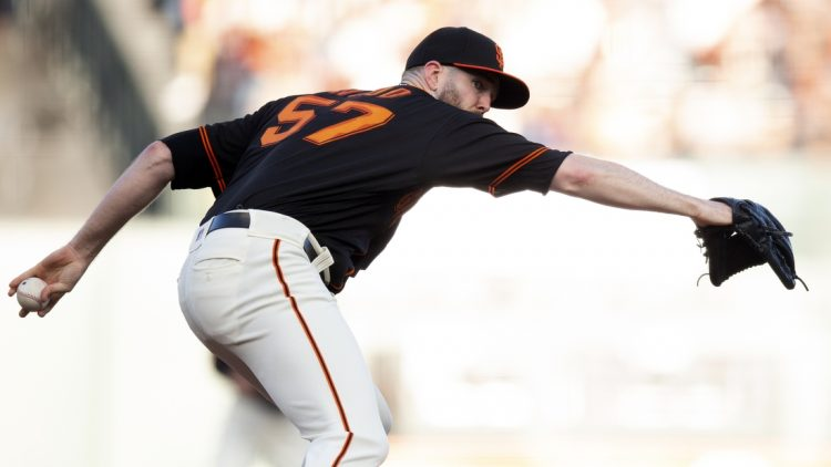 Sep 18, 2021; San Francisco, California, USA; San Francisco Giants starting pitcher Alex Wood (57) delivers against the Atlanta Braves during the first inning at Oracle Park. Mandatory Credit: D. Ross Cameron-USA TODAY Sports