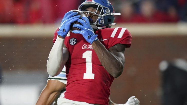 Sep 18, 2021; Oxford, Mississippi, USA; Mississippi Rebels wide receiver Jonathan Mingo (1) catches a touchdown pass against Tulane Green Wave at Vaught-Hemingway Stadium. Mandatory Credit: Marvin Gentry-USA TODAY Sports