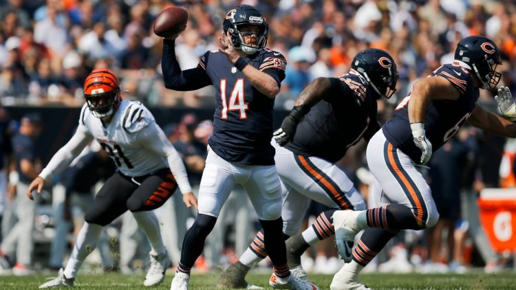 Chicago Bears quarterback Andy Dalton (14) throws a pass in the first quarter of the NFL Week 2 game between the Chicago Bears and the Cincinnati Bengals at Soldier Field in Chicago on Sunday, Sept. 19, 2021. The Bears led 7-0 at halftime.Cincinnati Bengals At Chicago Bears