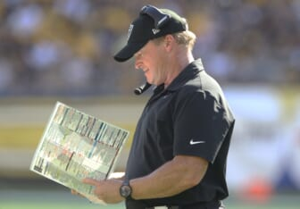 Sep 19, 2021; Pittsburgh, Pennsylvania, USA;  Las Vegas Raiders head coach Jon Gruden looks at his play chart against the Pittsburgh Steelers during the fourth quarter at Heinz Field. Las Vegas won 26-17.  Mandatory Credit: Charles LeClaire-USA TODAY Sports