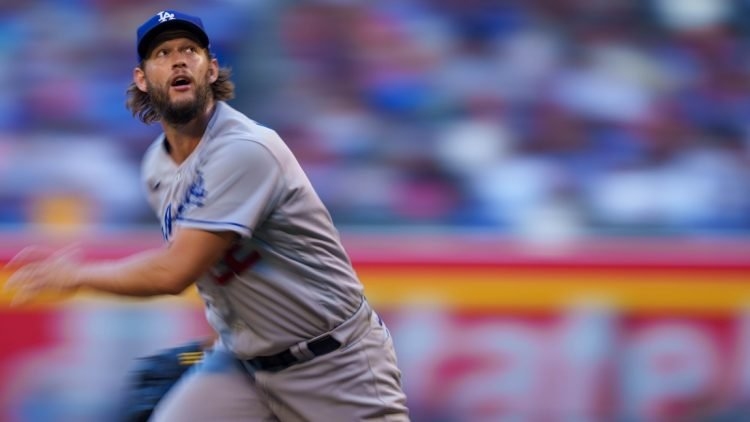 Sep 25, 2021; Phoenix, Arizona, USA; Los Angeles Dodgers starting pitcher Clayton Kershaw (22) pitches against the Arizona Diamondbacks during the fourth inning at Chase Field. Mandatory Credit: Allan Henry-USA TODAY Sports