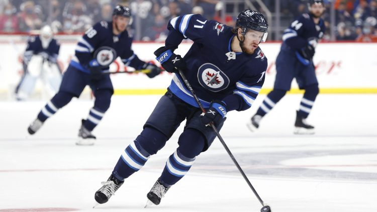 Sep 29, 2021; Winnipeg, Manitoba, CAN;  Winnipeg Jets right wing Evgeny Svechnikov (71) skates up the ice against the Edmonton Oilers in the second period at Canada Life Centre. Mandatory Credit: James Carey Lauder-USA TODAY Sports