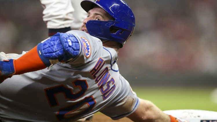 Oct 1, 2021; Atlanta, Georgia, USA; New York Mets first baseman Pete Alonso (20) reacts after sliding safely into third past the tag of Atlanta Braves third baseman Ehire Adrianza (not pictured) in the fourth inning at Truist Park. Mandatory Credit: Brett Davis-USA TODAY Sports