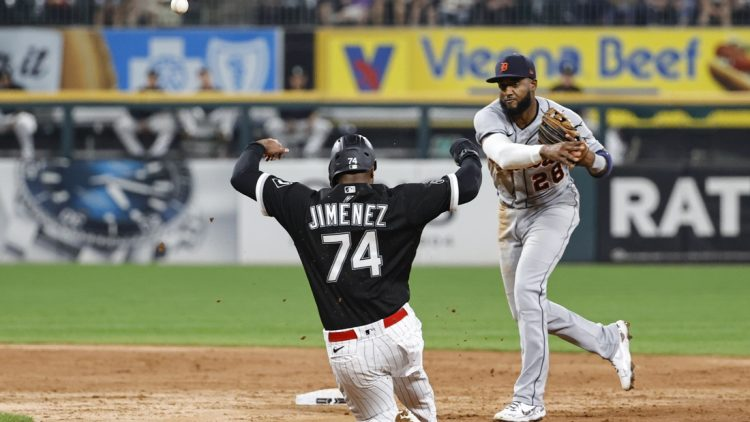 Oct 1, 2021; Chicago, Illinois, USA; Detroit Tigers third baseman Niko Goodrum (28) throws out Chicago White Sox left fielder Eloy Jimenez (74) at second base during the third inning at Guaranteed Rate Field. Mandatory Credit: Kamil Krzaczynski-USA TODAY Sports