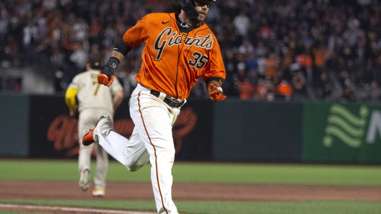 Oct 1, 2021; San Francisco, California, USA; San Francisco Giants shortstop Brandon Crawford (35) heads home on an RBI single by Mike Yastrzemski during the first inning against the San Diego Padres at Oracle Park. Mandatory Credit: D. Ross Cameron-USA TODAY Sports