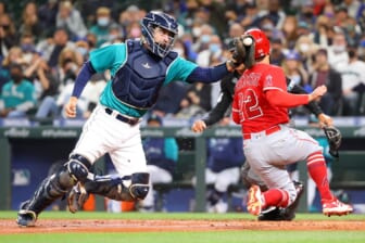Oct 1, 2021; Seattle, Washington, USA;  Los Angeles Angels second baseman David Fletcher (22) beats the tag by Seattle Mariners catcher Tom Murphy (2) to score and take a 2-1 lead during the third inning at T-Mobile Park. Mandatory Credit: Abbie Parr-USA TODAY Sports