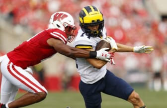 Oct 2, 2021; Madison, Wisconsin, USA;  Michigan Wolverines wide receiver Roman Wilson (14) is tackled after catching a pass during the first quarter against the Wisconsin Badgers at Camp Randall Stadium. Mandatory Credit: Jeff Hanisch-USA TODAY Sports