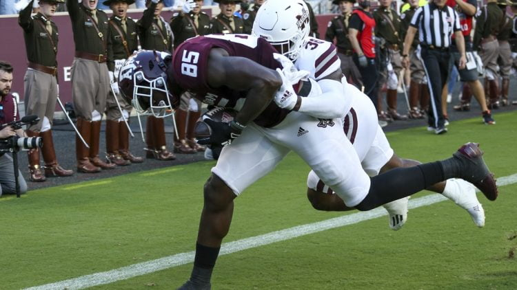Oct 2, 2021; College Station, Texas, USA; Texas A&M Aggies tight end Jalen Wydermyer (85) catches a touchdown pass against Mississippi State Bulldogs safety Fred Peters (38)  in the first quarter at Kyle Field. Mandatory Credit: Thomas Shea-USA TODAY Sports