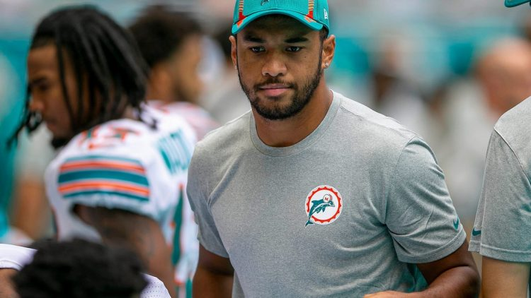 Miami Dolphins Miami Dolphins quarterback Tua Tagovailoa (1) greets teammates before the start of the game against Indianapolis Colts during NFL game at Hard Rock Stadium Sunday in Miami Gardens.