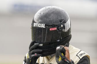 Oct 3, 2021; Talladega, Alabama, USA; NASCAR Cup Series official has rain beading up on his helmet prior to the postponing of the race  at Talladega Superspeedway. Mandatory Credit: Marvin Gentry-USA TODAY Sports