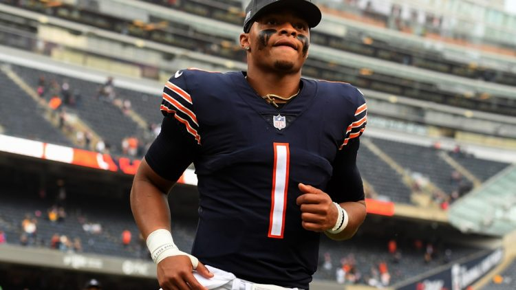 Oct 3, 2021; Chicago, Illinois, USA; Chicago Bears quarterback Justin Fields (1) leaves the field after the game against the Detroit Lions at Soldier Field. Mandatory Credit: Quinn Harris-USA TODAY Sports