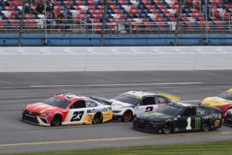 Oct 4, 2021; Talladega, Alabama, USA; NASCAR Cup Series driver Bubba Wallace (23) leads a pack of cars during the YellaWood 500 at Talladega Superspeedway. Mandatory Credit: Adam Hagy-USA TODAY Sports