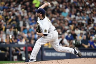 Oct 8, 2021; Milwaukee, Wisconsin, USA; Milwaukee Brewers starting pitcher Corbin Burnes (39) pitches in the fourth inning against the Atlanta Braves during game one of the 2021 NLDS at American Family Field. Mandatory Credit: Benny Sieu-USA TODAY Sports