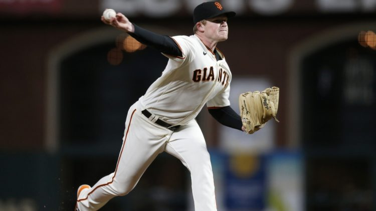 Oct 8, 2021; San Francisco, California, USA; San Francisco Giants starting pitcher Logan Webb (62) pitches against the Los Angeles Dodgers in the sixth inning during game one of the 2021 NLDS at Oracle Park. Mandatory Credit: D. Ross Cameron-USA TODAY Sports