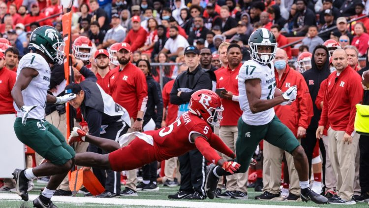 Oct 9, 2021; Piscataway, New Jersey, USA; Michigan State Spartans wide receiver Tre Mosley (17) is tackled by Rutgers Scarlet Knights defensive back Kessawn Abraham (5) during the first half at SHI Stadium. Mandatory Credit: Vincent Carchietta-USA TODAY Sports