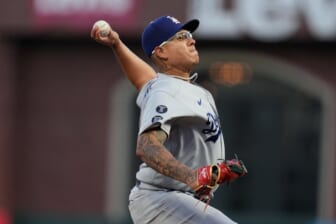 Oct 9, 2021; San Francisco, California, USA; Los Angeles Dodgers starting pitcher Julio Urias (7) throws against the San Francisco Giants in the first inning during game two of the 2021 NLDS at Oracle Park. Mandatory Credit: Neville E. Guard-USA TODAY Sports