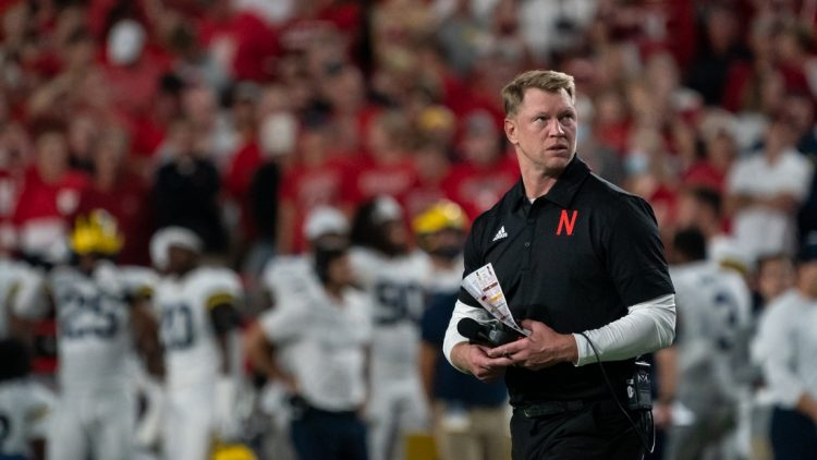 Oct 9, 2021; Lincoln, Nebraska, USA; Nebraska Cornhuskers head coach Scott Frost walks off the field after an injury timeout following a play against the Michigan Wolverines during the fourth quarter at Memorial Stadium. Mandatory Credit: Dylan Widger-USA TODAY Sports