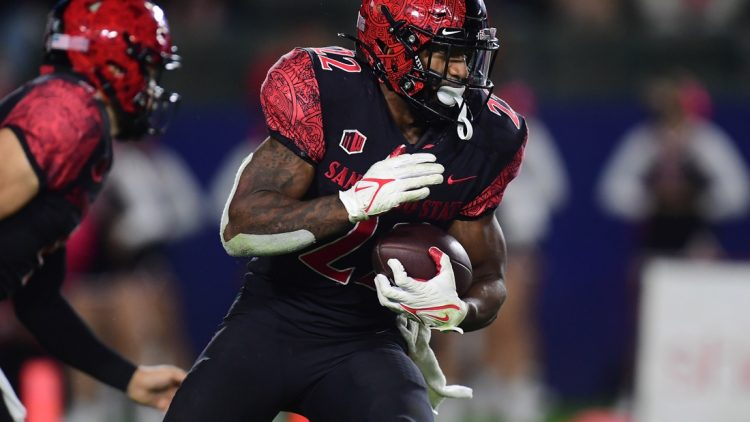 Oct 9, 2021; Carson, California, USA; San Diego State Aztecs running back Greg Bell (22) runs the ball against the New Mexico Lobos during the second half at Dignity Health Sports Park. Mandatory Credit: Gary A. Vasquez-USA TODAY Sports