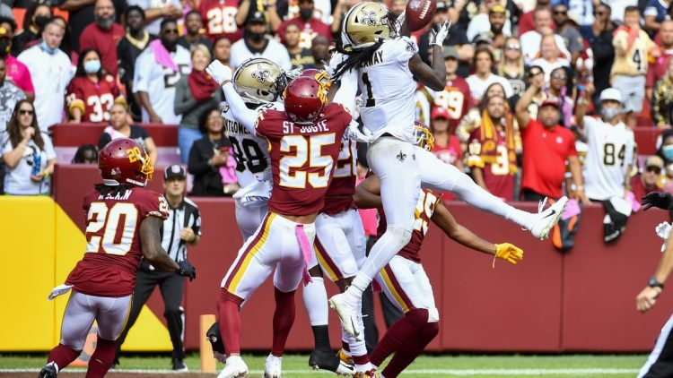 Oct 10, 2021; Landover, Maryland, USA; New Orleans Saints wide receiver Marquez Callaway (1) catches a touchdown  pass against the Washington Football Team during the first half at FedExField. Mandatory Credit: Brad Mills-USA TODAY Sports