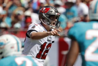 Oct 10, 2021; Tampa, Florida, USA; Tampa Bay Buccaneers quarterback Tom Brady (12) throws the ball against the Miami Dolphins during the first half at Raymond James Stadium. Mandatory Credit: Kim Klement-USA TODAY Sports