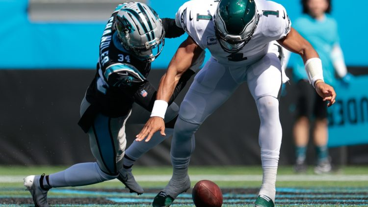 Oct 10, 2021; Charlotte, North Carolina, USA; Philadelphia Eagles quarterback Jalen Hurts (1) and Carolina Panthers defensive back Sean Chandler (34) fight for a fumble in the end zone during the first half at Bank of America Stadium. Mandatory Credit: Douglas DeFelice-USA TODAY Sports