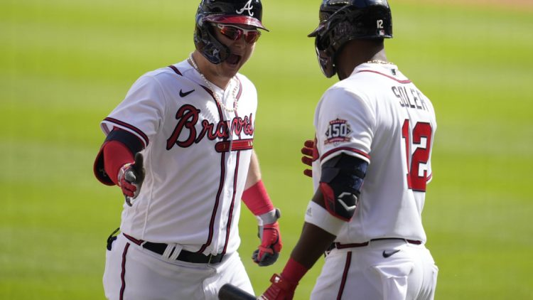Oct 11, 2021; Cumberland, GA, USA; Atlanta Braves left fielder Joc Pederson (22) celebrates with right fielder Jorge Soler (12) after hitting a three-run home run against the Milwaukee Brewers during the fifth inning during game three of the 2021 ALDS at Truist Park. Mandatory Credit: Dale Zanine-USA TODAY Sports