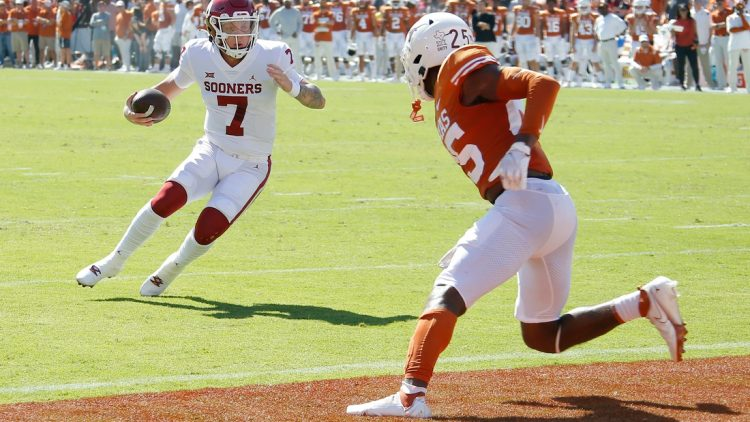 OU quarterback Spencer Rattler (7) runs for a touchdown in front of Texas' B.J. Foster (25) during the first half Saturday in Dallas.  jump