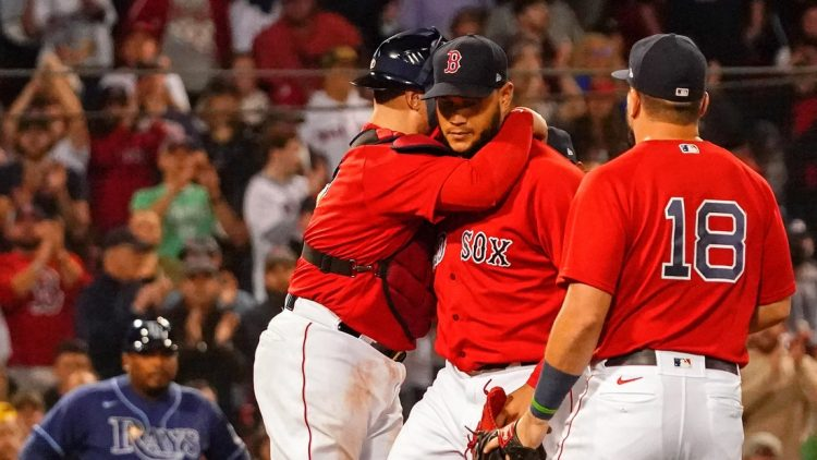 Oct 11, 2021; Boston, Massachusetts, USA; Boston Red Sox catcher Christian Vazquez (7) hugs starting pitcher Eduardo Rodriguez (57) during the sixth inning against the Tampa Bay Rays during game four of the 2021 ALDS at Fenway Park. Mandatory Credit: David Butler II-USA TODAY Sports