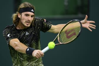 Oct 12, 2021; Indian Wells, CA, USA; Stefanos Tsitsipas (GRE) hits a shot against Fabio Fognini (ITA) during a third round match in the BNP Paribas Open at the Indian Wells Tennis Garden. Mandatory Credit: Jayne Kamin-Oncea-USA TODAY Sports