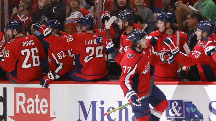 Oct 13, 2021; Washington, District of Columbia, USA; Washington Capitals right wing T.J. Oshie (77) celebrates with teammates after scoring a goal against the New York Rangers during the first period at Capital One Arena. Mandatory Credit: Geoff Burke-USA TODAY Sports