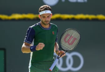Grigor Dimitrov of Bulgaria celebrates a point against Daniil Medvedev of Russia during their round four match of the BNP Paribas Open, Wednesday, Oct. 13, 2021, in Indian Wells, Calif.